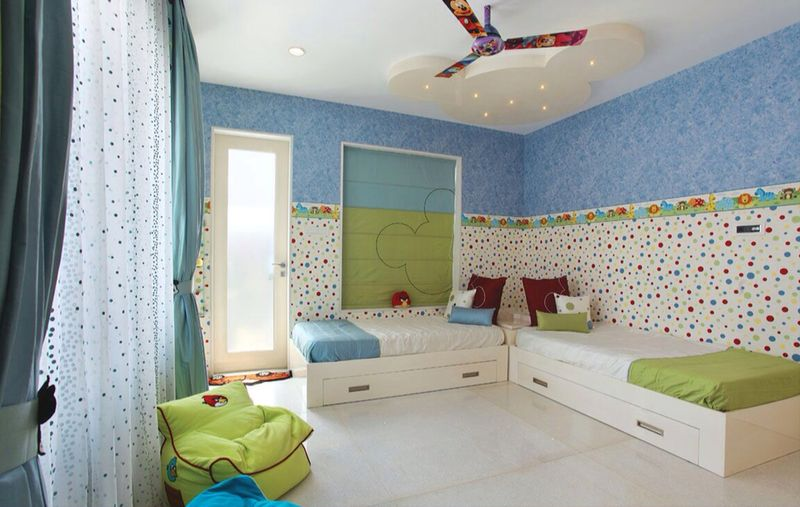 Vibrant kid's bedroom with two single bed and Mickey shaped false ceiling by R. Gautam Jain Bedroom Modern | Interior Design Photos & Ideas