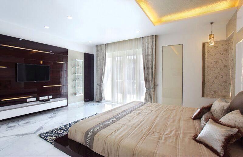 Spacious Bedroom With Dark Wooden Television  Cabinet by R. Gautam Jain Bedroom Contemporary | Interior Design Photos & Ideas