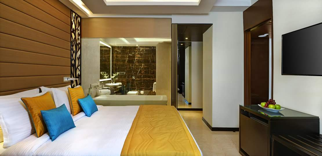 Bedroom With Brick Like Wooden Tiles by R. Gautam Jain Bedroom Contemporary | Interior Design Photos & Ideas