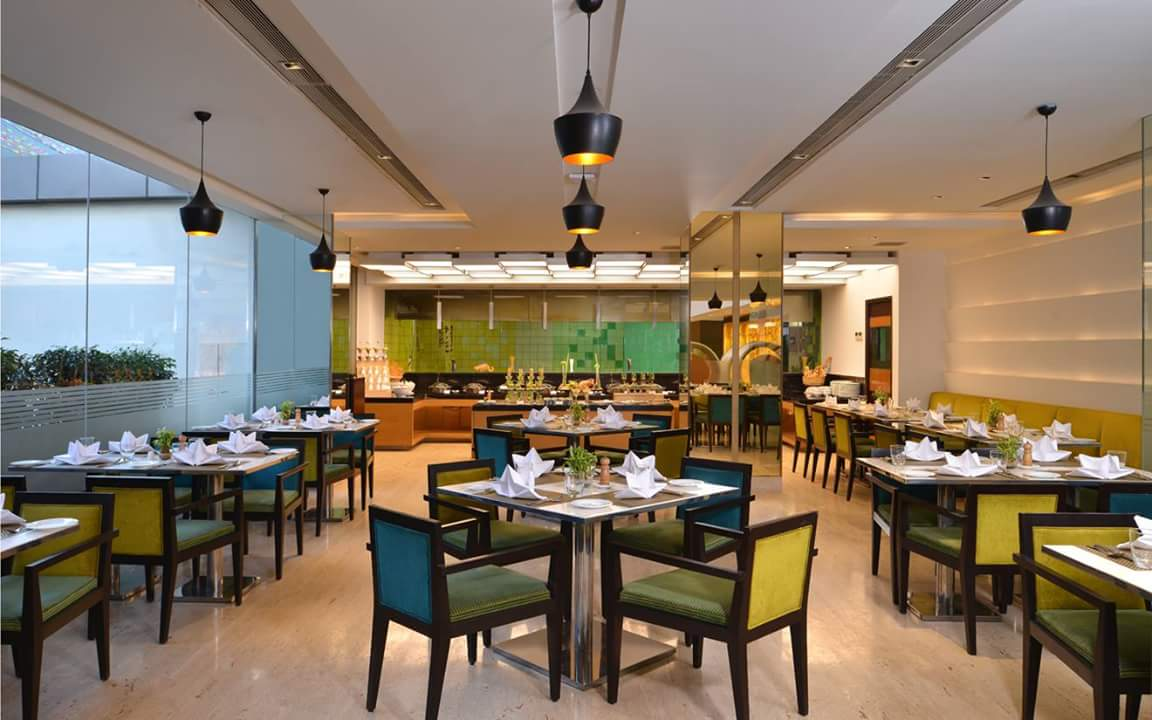 Restaurant With Green Chairs by R. Gautam Jain Contemporary | Interior Design Photos & Ideas