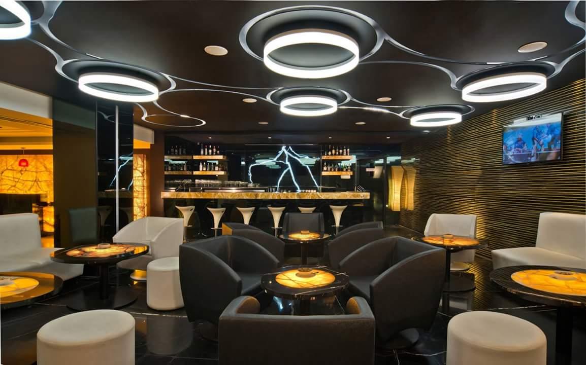 Bar With Brown Sofas by R. Gautam Jain Contemporary | Interior Design Photos & Ideas