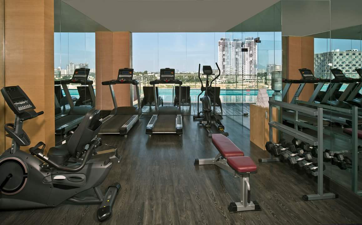 Hardwood flooring gym with stationery glass panel by R. Gautam Jain Modern | Interior Design Photos & Ideas