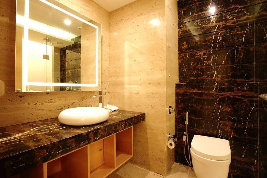Brown Tiled Bathroom by R. Gautam Jain Bathroom Modern | Interior Design Photos & Ideas