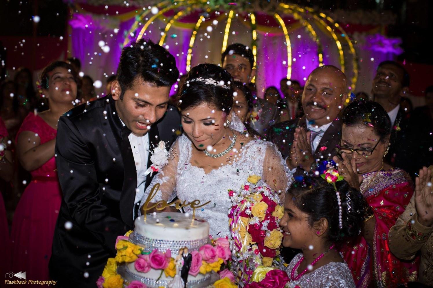 Christian Bride and Groom Cutting Their Wedding Cake by Lloyd Bangera Wedding-photography | Weddings Photos & Ideas