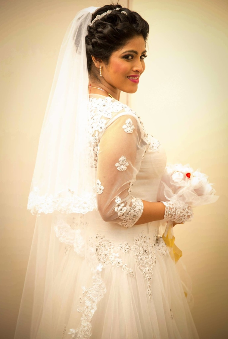 Bride Wearing Exquisite White Net Gown by Lloyd Bangera Wedding-dresses | Weddings Photos & Ideas