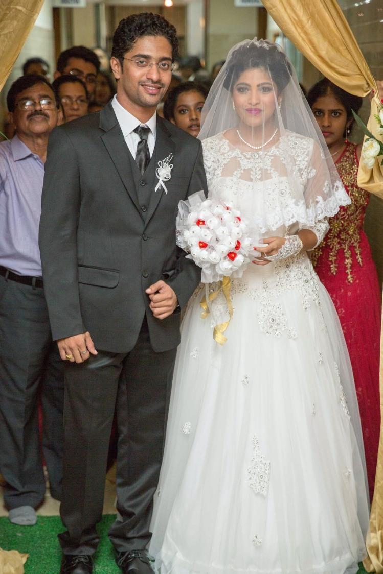 Christian Bride and Groom Wearing Elegant Formal Wear by Lloyd Bangera Wedding-photography Groom-wear-and-accessories Wedding-dresses | Weddings Photos & Ideas