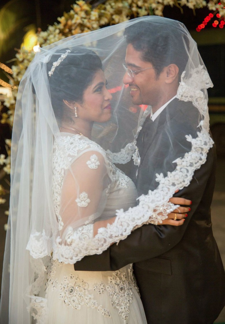 Christian Bride and Groom Striking a Romantic Pose by Lloyd Bangera Wedding-photography | Weddings Photos & Ideas