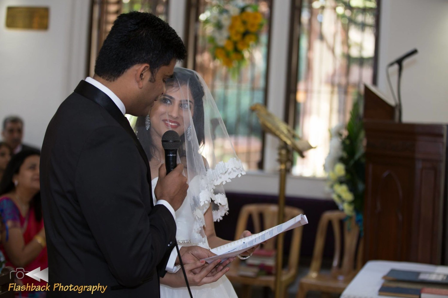 Candid moment of Bride and Groom Reading Their Wedding Vows by Lloyd Bangera Wedding-photography | Weddings Photos & Ideas