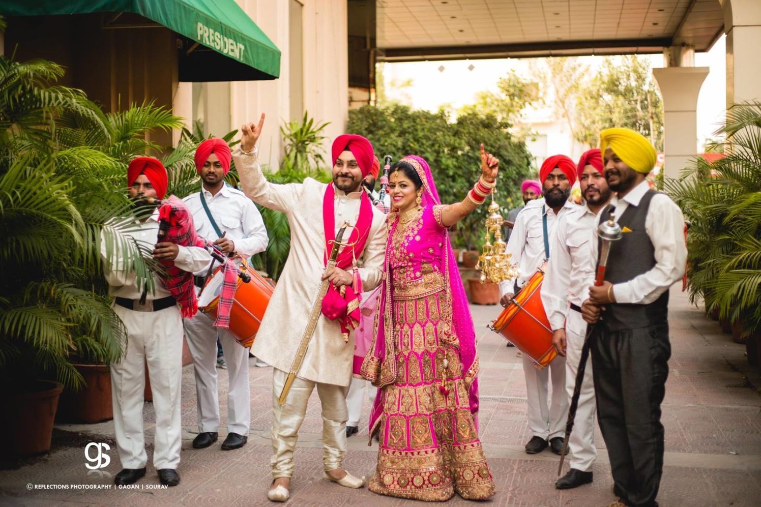 Candid Photo of the Bride and Groom Making a Dance Pose by Sourav Samanta Wedding-photography Groom-wear-and-accessories Wedding-dresses | Weddings Photos & Ideas