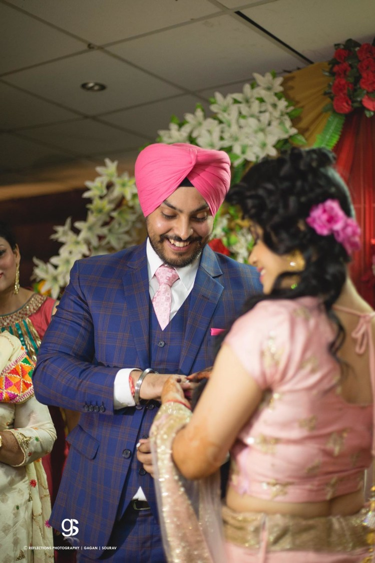 Candid Capture of the Bride and Groom During Their Ring Ceremony by Sourav Samanta Wedding-photography Groom-wear-and-accessories | Weddings Photos & Ideas