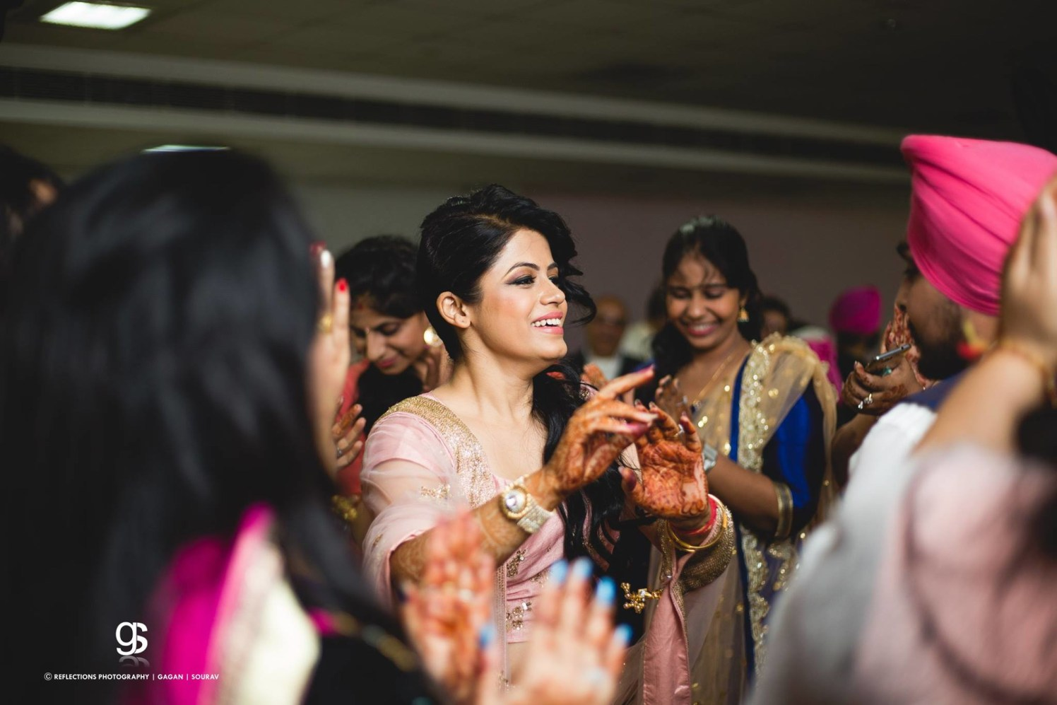 Candid Photo of the Bride From Her Engagement Day Dance by Sourav Samanta Wedding-photography Bridal-makeup | Weddings Photos & Ideas