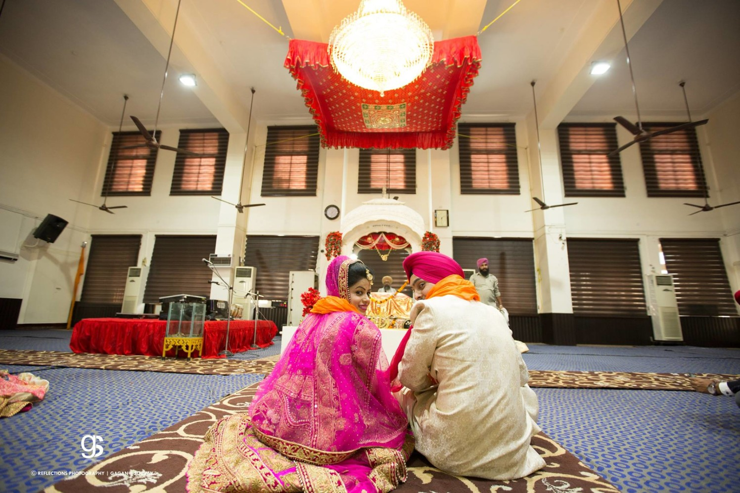 Backdrop of the Wedding Venue Against the Portrait of the Bride and Groom by Sourav Samanta Wedding-photography   Weddings Photos & Ideas