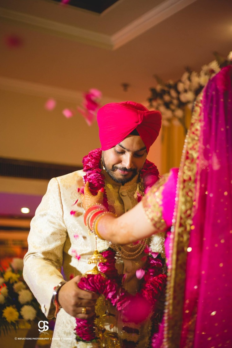 Candid Capture of the Groom During His Jaimala Ceremony by Sourav Samanta Wedding-photography | Weddings Photos & Ideas