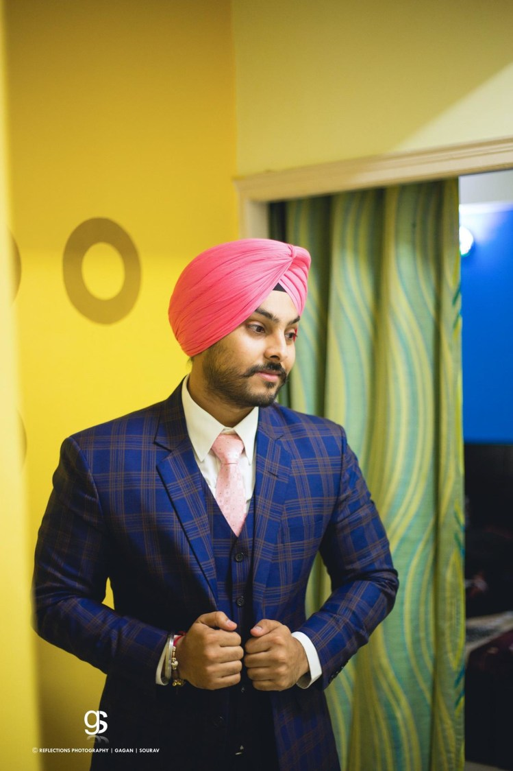 Groom Wearing Navy Blue Chequered Suit With Pink Turban by Sourav Samanta Wedding-photography Groom-wear-and-accessories | Weddings Photos & Ideas
