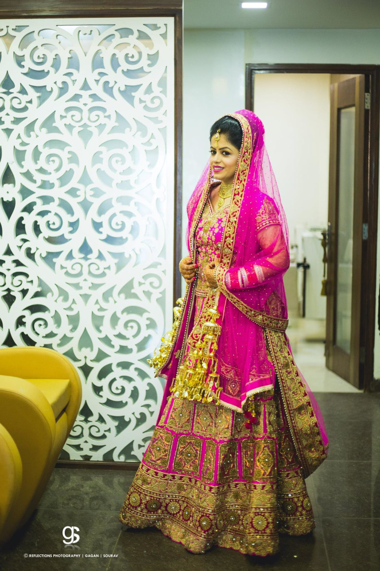 Beautiful Deep Pink Lehenga With Golden Threadwork For Day time Weddings by Sourav Samanta Wedding-photography Wedding-dresses | Weddings Photos & Ideas