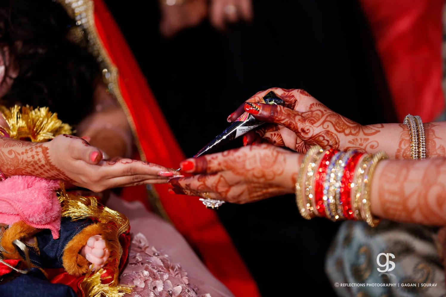 Putting the mehendi! by Reflections Photography Wedding-photography | Weddings Photos & Ideas