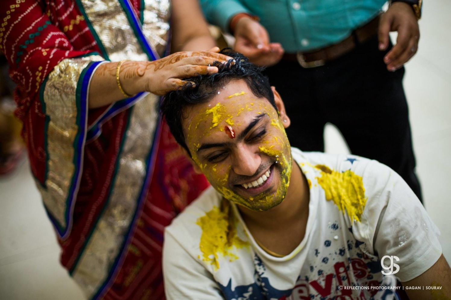 Drenched in haldi! by Reflections Photography