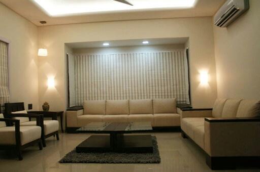 Austere Living Room by Irashri Infrastructure Modern Contemporary | Interior Design Photos & Ideas