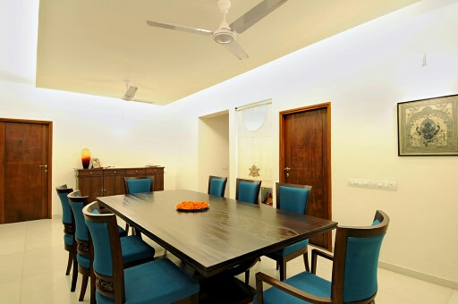Minimalistic Dining Room by Irashri Infrastructure Contemporary Minimalistic | Interior Design Photos & Ideas