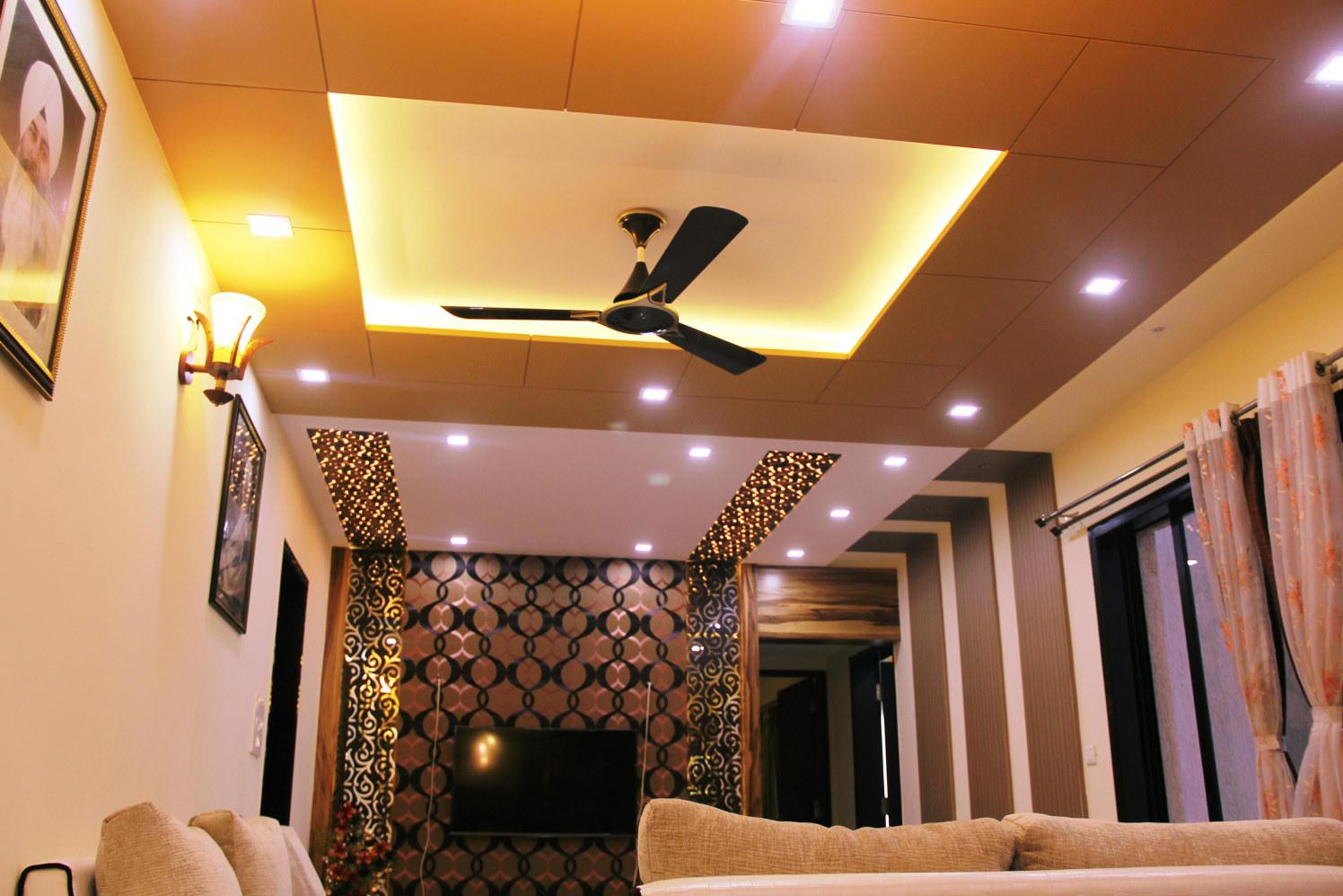Living Area With Textured Wall And Designer Ceiling by Vibhuti Fotedar Living-room Contemporary | Interior Design Photos & Ideas
