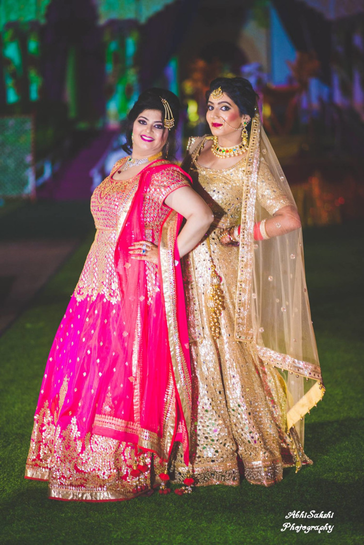 Pretty ladies posing by AbhiSakshi Photography Wedding-photography | Weddings Photos & Ideas