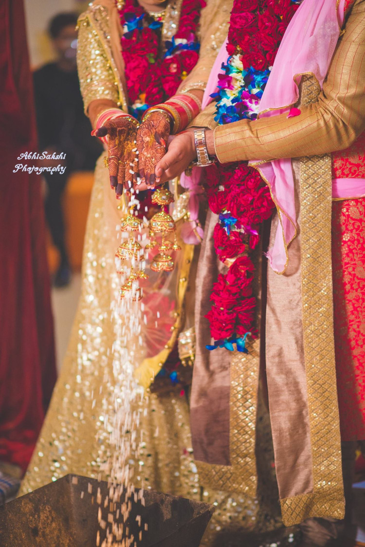 Bride and Groom performing rituals by AbhiSakshi Photography Wedding-photography | Weddings Photos & Ideas