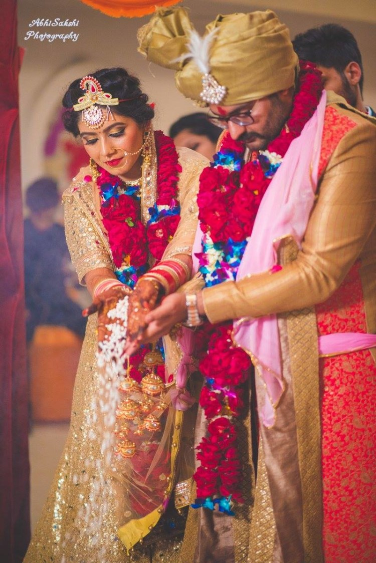 Perfect click of couple performing rituals by AbhiSakshi Photography Wedding-photography | Weddings Photos & Ideas