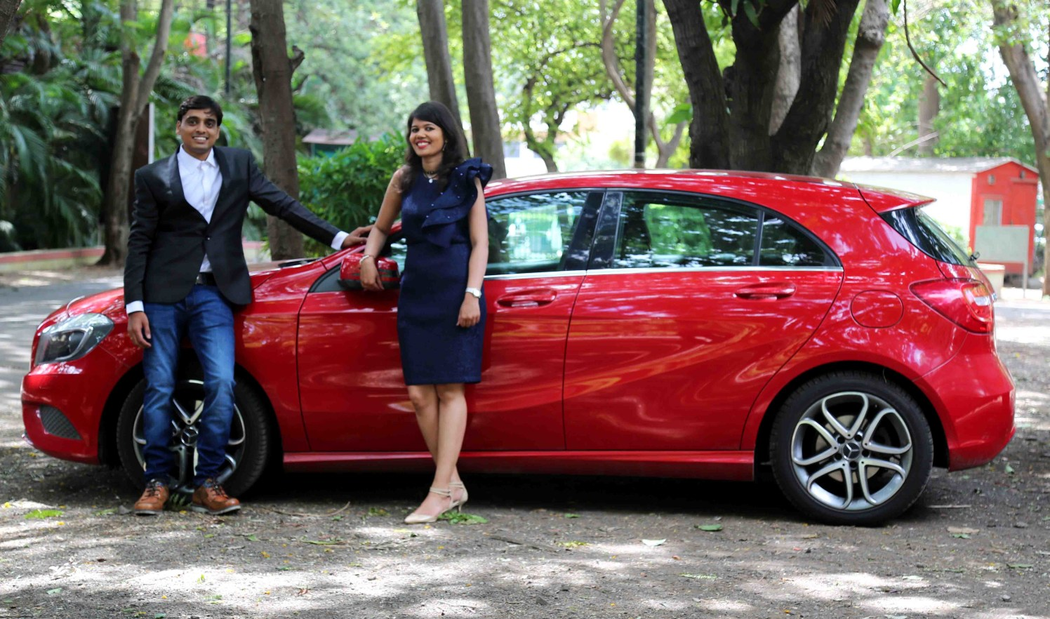 Bride and Groom To-Be Pose Against a Swanky Red Car by Rushil Jadhav Wedding-photography | Weddings Photos & Ideas