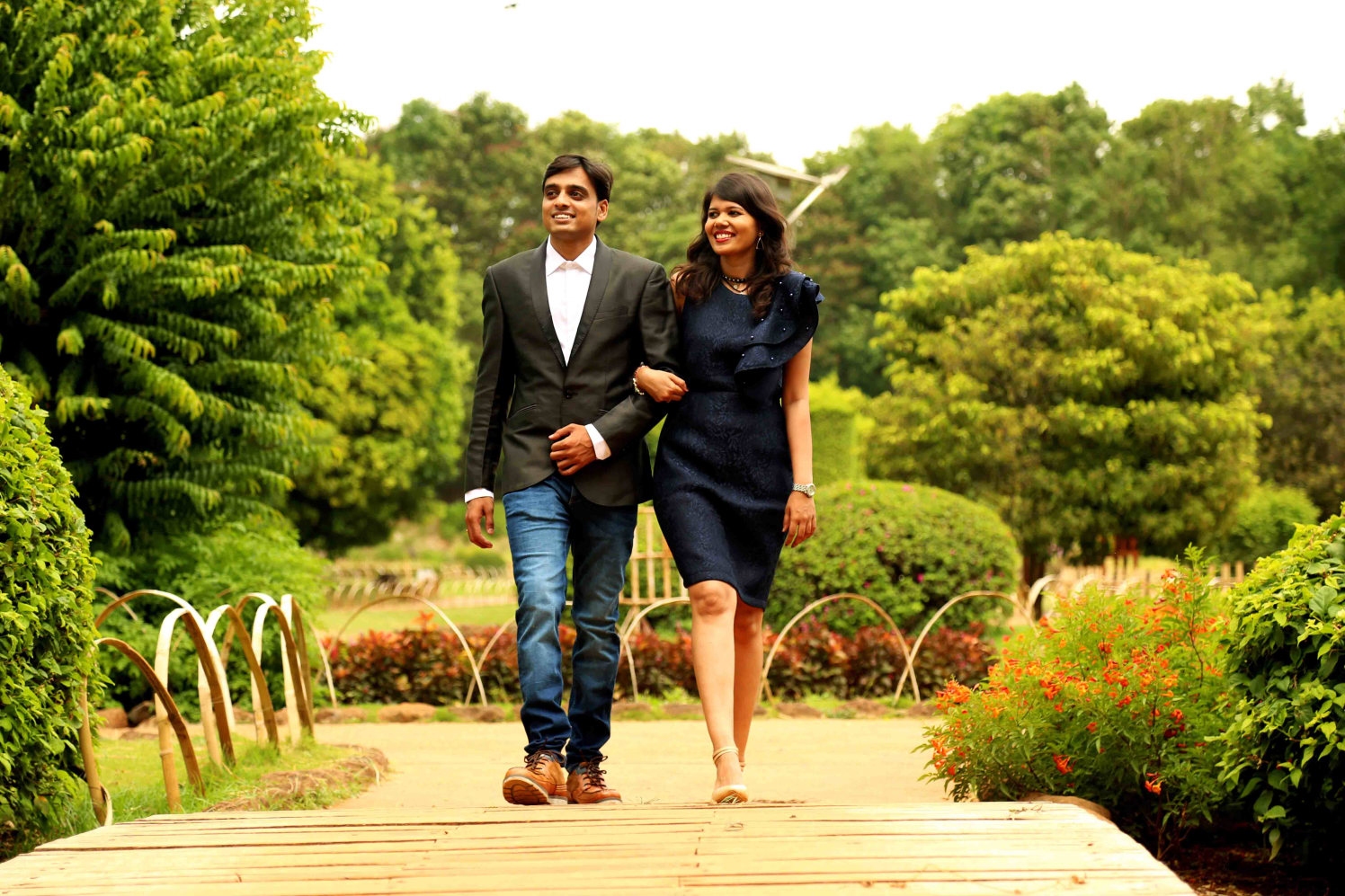 Candid Click of Bride and Groom To-Be Against Picturesque Garden Backdrop by Rushil Jadhav Wedding-photography | Weddings Photos & Ideas
