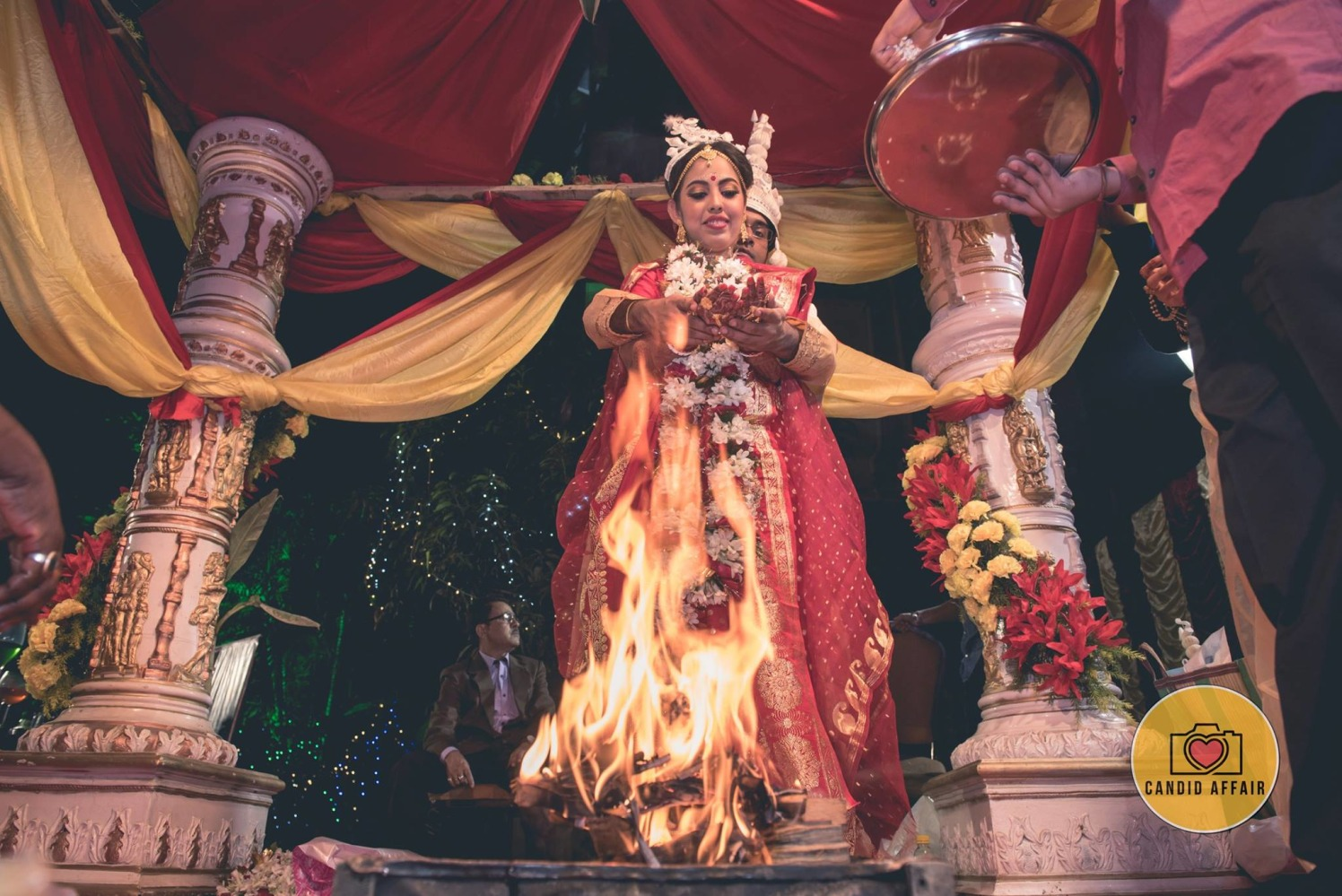 A Stunning Shot Of The Couple Performing Wedding Ritual by Candid Affair Wedding-photography | Weddings Photos & Ideas