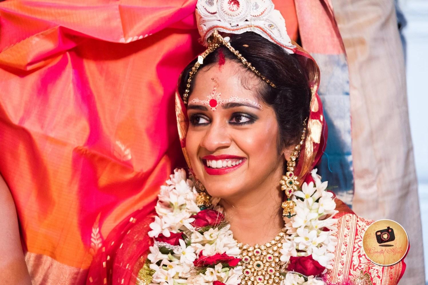 Bengali Bride With Chandan Makeup And Bold Makeup by Candid Affair Wedding-photography Bridal-makeup | Weddings Photos & Ideas
