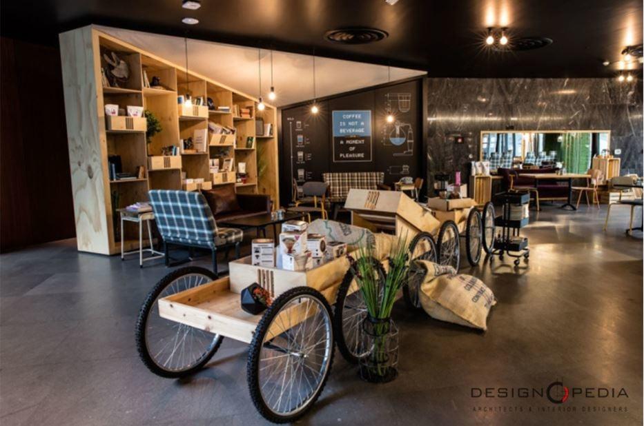 Garage Themed Cafe by Designopedia Modern | Interior Design Photos & Ideas