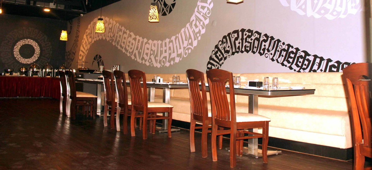 Restaurant Space with Metallic Tables and Wooden Chairs by Trupti Ladda Contemporary | Interior Design Photos & Ideas