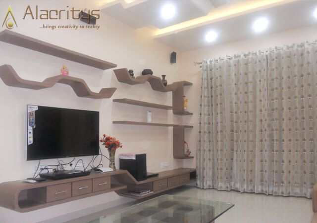 Living Room with Tv Unit And Brown Glossy Display Unit by Trupti Ladda Living-room Minimalistic | Interior Design Photos & Ideas