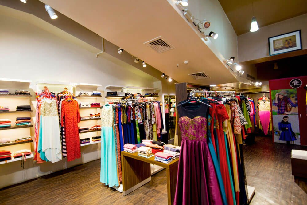 Traditional Clothing Showroom with wooden Shelves and Flooring by Trupti Ladda Contemporary | Interior Design Photos & Ideas