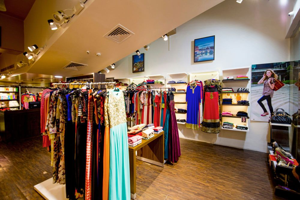 Traditional Clothing Showroom with Wood Flooring and False Ceiling by Trupti Ladda Contemporary | Interior Design Photos & Ideas