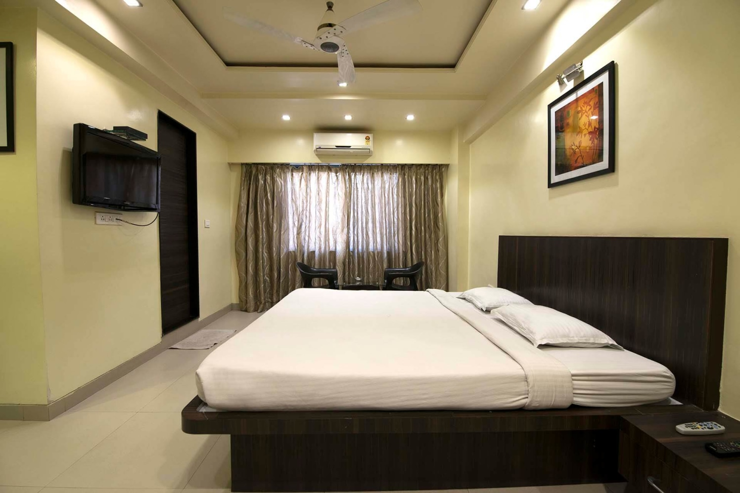 Simple Bedroom with Wooden Finished Queen Size Bed and Marble Flooring by Trupti Ladda Bedroom Minimalistic | Interior Design Photos & Ideas