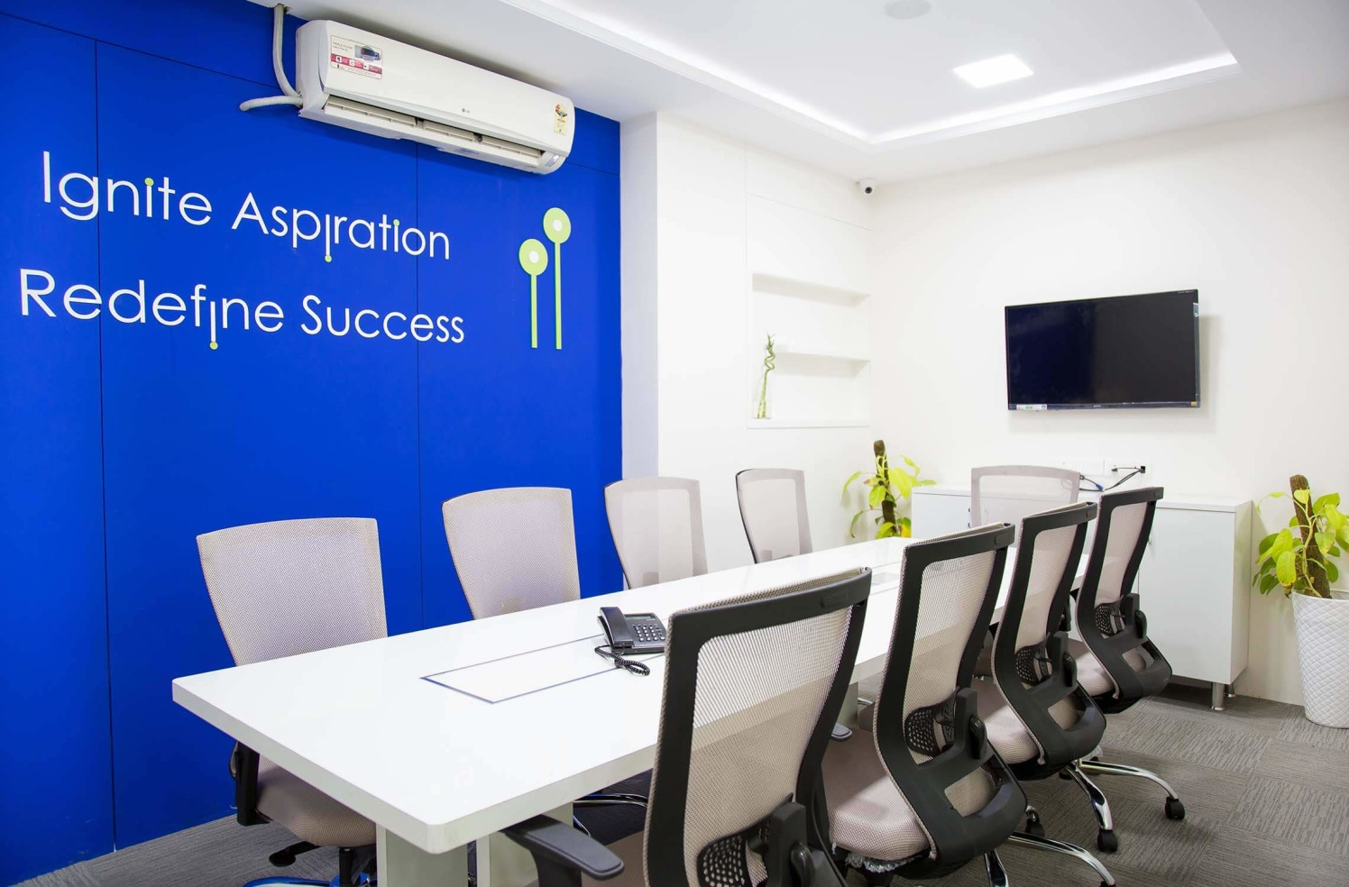 Conference Room with White Table and Blue Wall by Trupti Ladda Contemporary | Interior Design Photos & Ideas