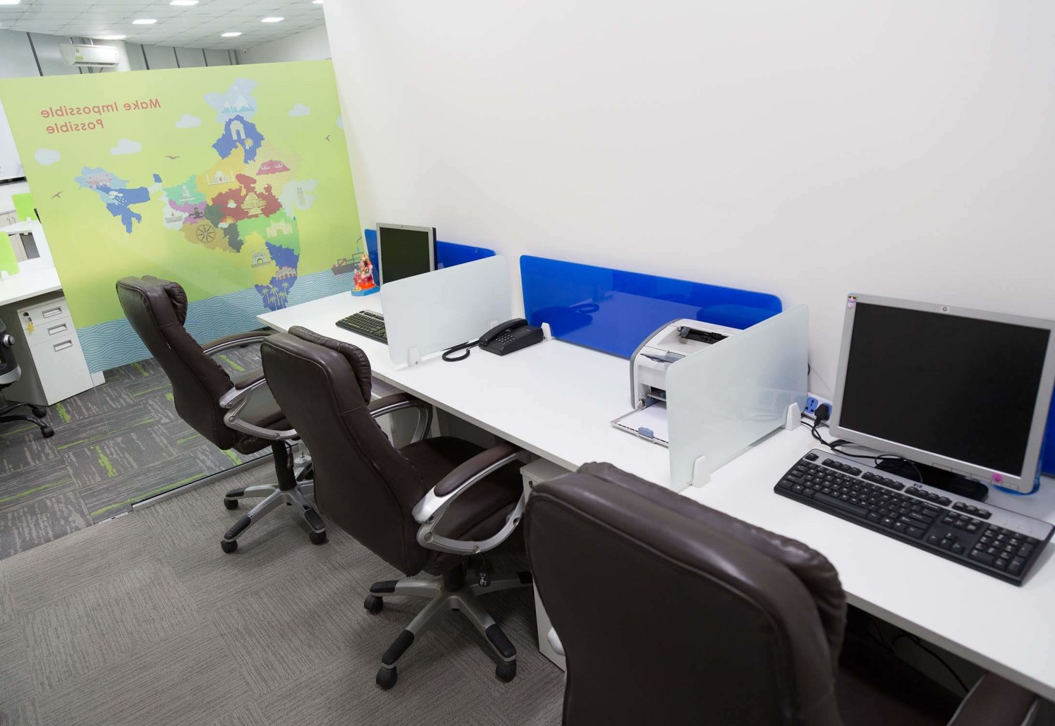 Basic Office Space with White Desk and Brown Chairs by Trupti Ladda Contemporary | Interior Design Photos & Ideas