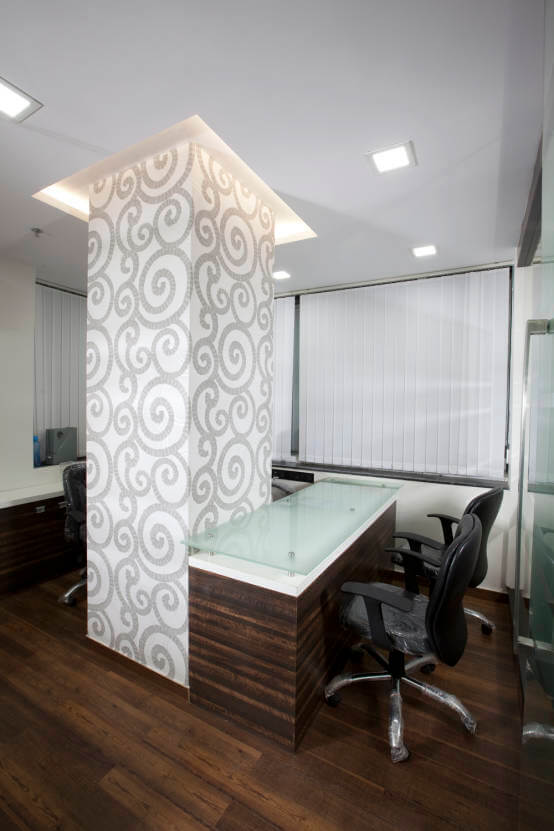 Work Space with Glass Top Desk and White Patterned Pillar by Trupti Ladda Contemporary | Interior Design Photos & Ideas