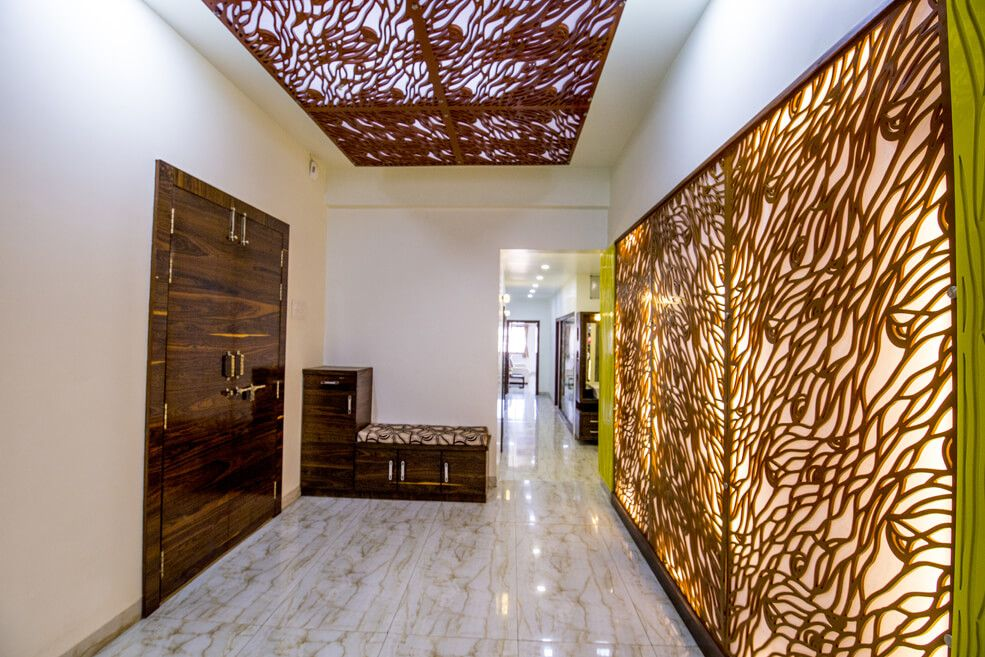 Walnut Brown Wooden Gate and Small Cabinets with Glossy Finish and Patterned Tiles Flooring by Trupti Ladda Indoor-spaces Contemporary | Interior Design Photos & Ideas
