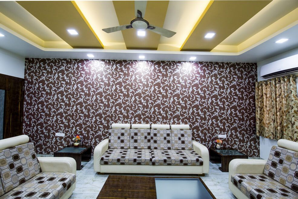 Living Room with Beige Sofa Set and Floral Designed Wall by Trupti Ladda Living-room Contemporary | Interior Design Photos & Ideas