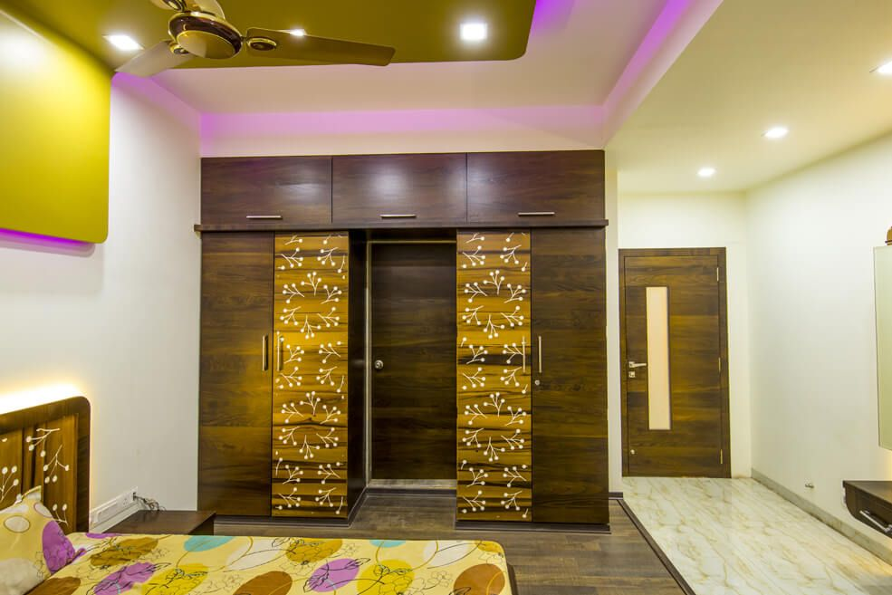 Master Bedroom with Wooden Closets and Cabinets by Trupti Ladda Bedroom Contemporary | Interior Design Photos & Ideas