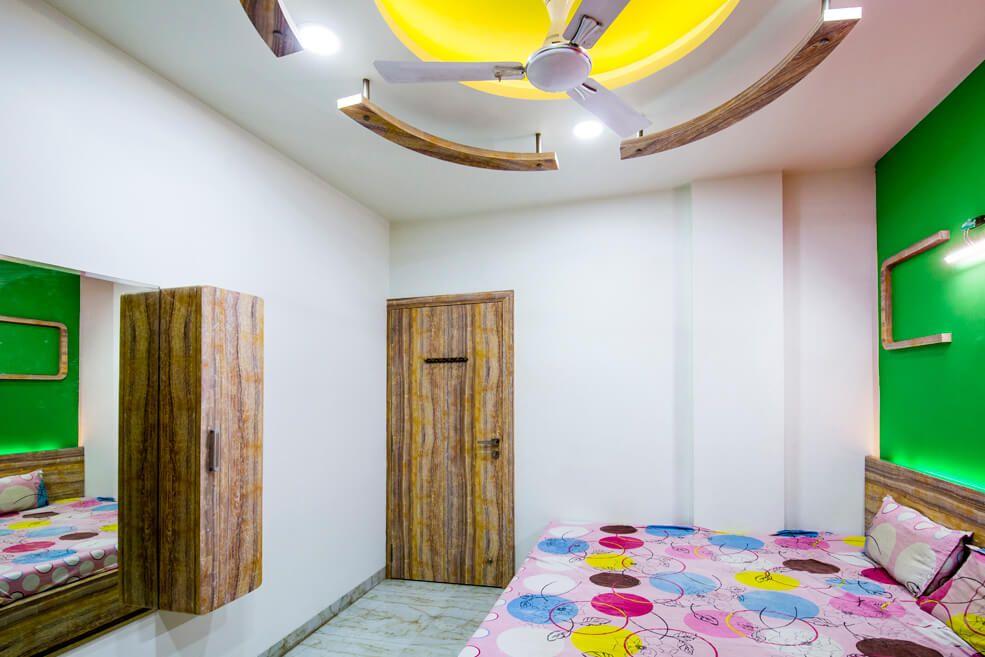 Master Bedroom with Wooden Cabinet and Door by Trupti Ladda Bedroom Contemporary | Interior Design Photos & Ideas