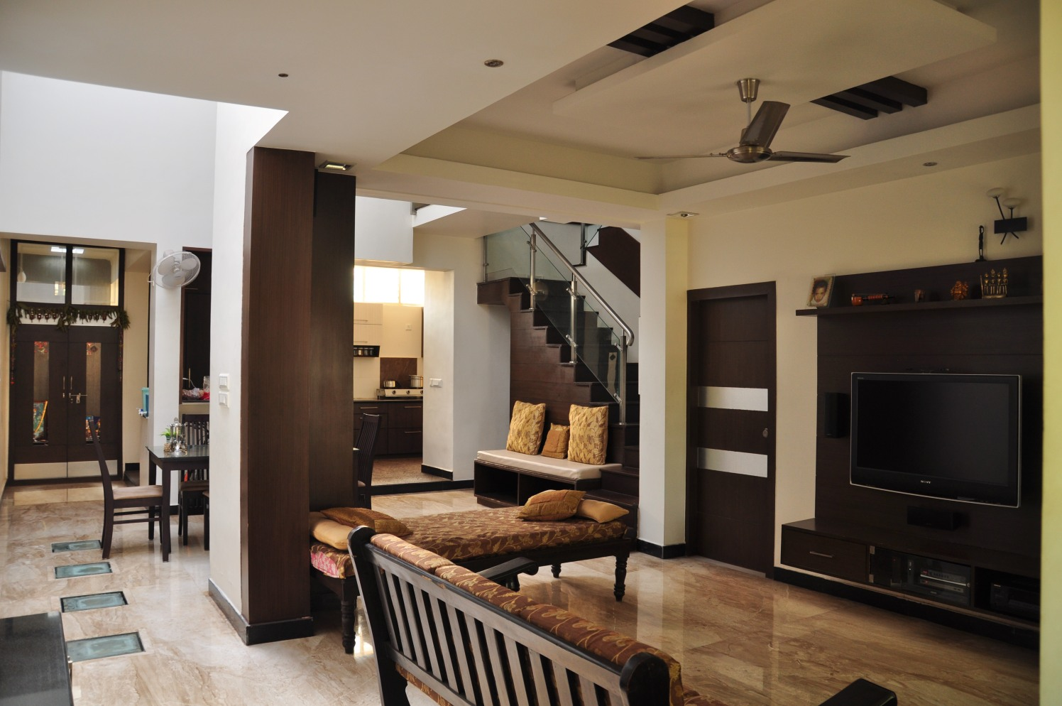 Spacious Living Room with Wooden Sofa and Brown Marble Flooring by Manasa Bharadwaj Living-room Contemporary | Interior Design Photos & Ideas