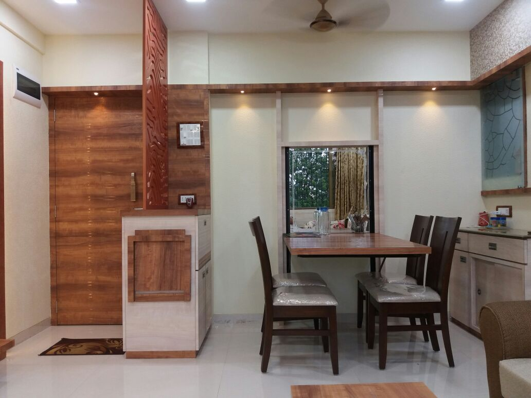 Dinning space with wooden designed furniture and wall decor by Nidhi Rathod Dining-room Modern | Interior Design Photos & Ideas