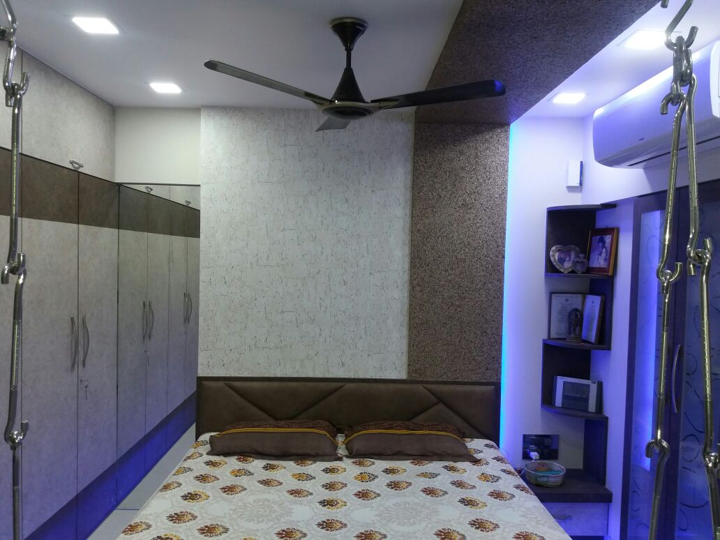 Bedroom with wall decor and wardrobe with blue  light by Nidhi Rathod Bedroom Modern | Interior Design Photos & Ideas
