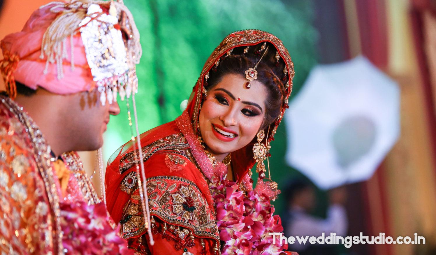 Gleeful bride by THE WEDDING STUDIO Wedding-photography Bridal-jewellery-and-accessories Bridal-makeup | Weddings Photos & Ideas