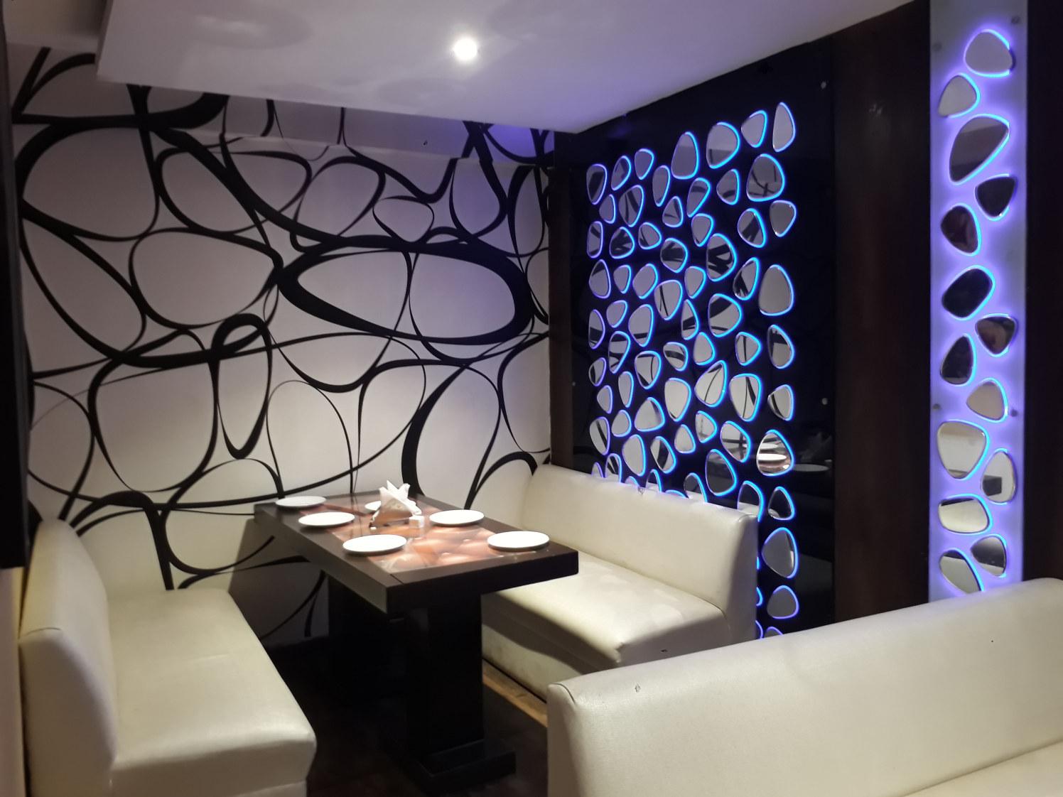 Stylish Restaurant with Designer Walls and White Sofas by Shailash Pandita Modern   Interior Design Photos & Ideas