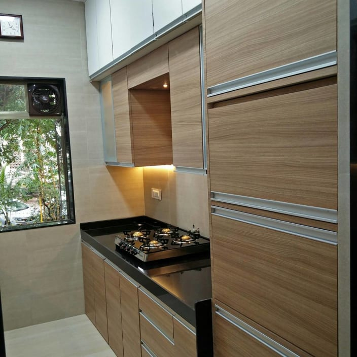Small Parallel Kitchen With Wooden Cabinets By Mitul Shah